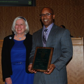 Wayne Beasley receiving the award from Mayor Barbara Halliday at the City Council meeting